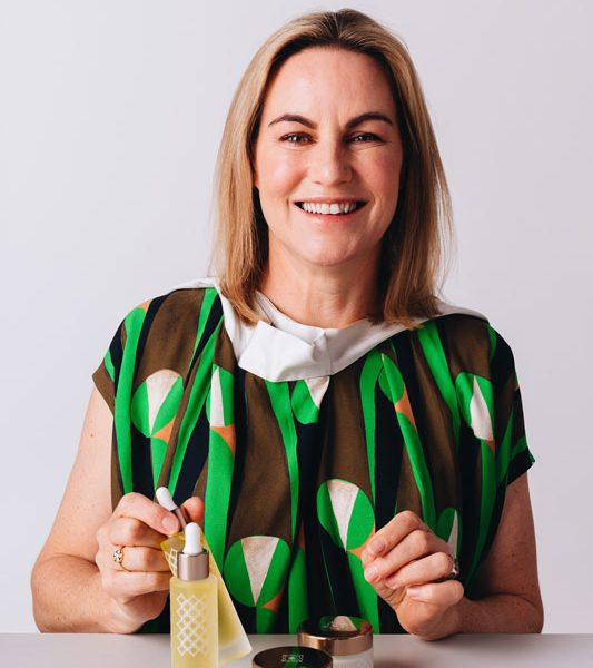 Sarah Bacon holding product